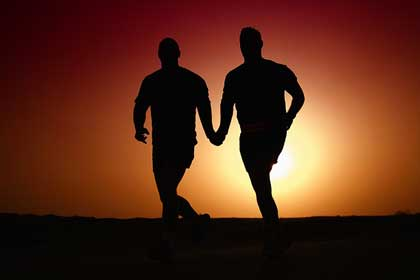 Couples Counseling at TheraThrive, image of gay couple running off in the sunset