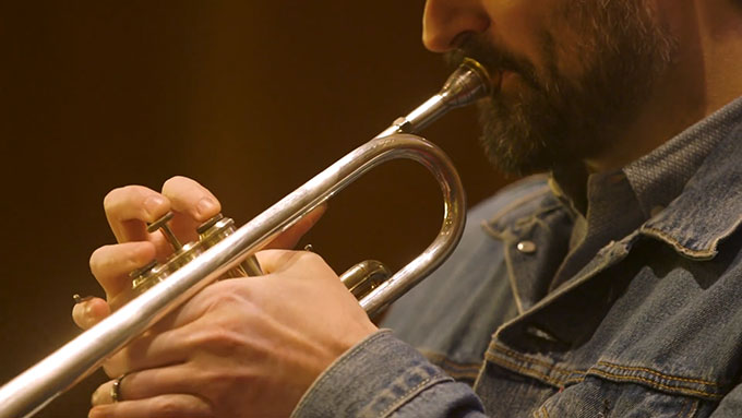 David Millen, therapist at TheraThrive, playing trumpet